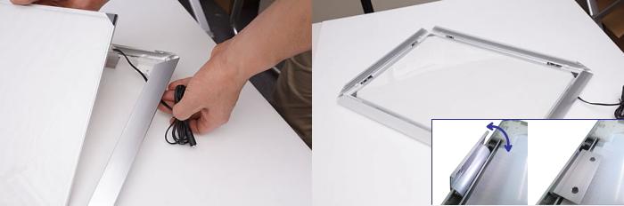 ② DCジャックをフレーム枠の下にくぐらせて、LEDパネルを組み込みます。同時に裏面の面ファスナを合わせて固定します。